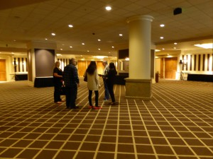 Zabrina, Chuck, Janette, Joel and a hotel employee studying the open area of the Conference floor, planned site of the internet lounge.